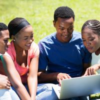 40868393 - group of african university students using laptop outdoors